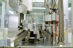 Automatic capsules filling. Automatic capsules filling in the plant has received GMP  PICs Pharmaceutical Inspection Co-operation Scheme Stock Image