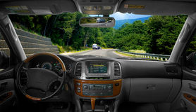 Automatic Car. Inside an automatic car without a driver, on a highway Royalty Free Stock Image
