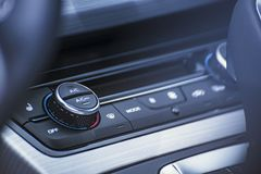 Automatic car air conditioner. Button for switching the modes of the air conditioner in the car Royalty Free Stock Images