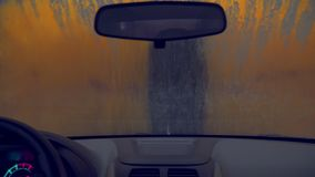 Automatic car wash. Station pf automatic car washing, view from inside of car stock video footage