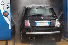 Automatic car wash. Washing machine step. Clean car royalty free stock photography