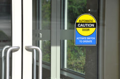 Automatic caution door sign Royalty Free Stock Photo