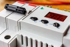 Automatic circuit breaker and voltage limiter installed in the mounting box closeup royalty free stock photos