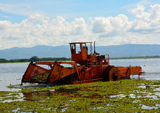 Automatic cleaning ship  are removing water hyacinth in marsh Royalty Free Stock Image