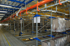 Automatic clothing warehouse. Photograph of an automatic warehouse of clothing made in italy Royalty Free Stock Photo