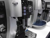 Automatic coffee machines at exhibition on white kitchen background royalty free stock image