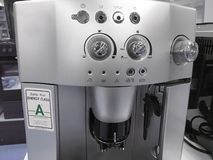 Automatic coffee machines at exhibition on white kitchen background royalty free stock photography