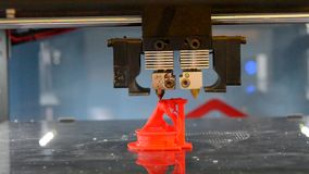 Automatic 3D printer performs red color plastic modeling objects. Objects red color printed by 3d printer. Fused deposition modeling, FDM. Progressive modern stock video