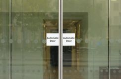 Automatic doors. Transparent sliding automatic doors on entrance to modern building stock photography