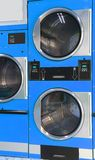 Automatic dryers coin operated in the laundromat Royalty Free Stock Photography
