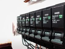 Automatic electricity switch circuit breaker control center box. Selective focus close up detail shot royalty free stock photography