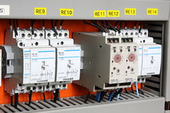 Automatic electricity switcher. Color wires in a box of distribution of an electricity stock photos