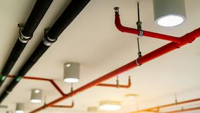 Automatic fire sprinkler safety system and black water cooling supply pipe. Fire Suppression. Fire protection and detector. Fire. Sprinkler system with red stock images