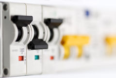 Automatic fuse-switches. Automatic circuit breakers in a fuse board royalty free stock photo