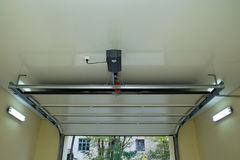 Automatic garage door inside. Automatic device for garage door inside stock photo