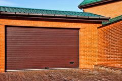 Automatic Garage Gate and Single Red House with brick wall, XXXL Stock Photography