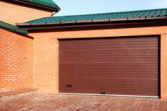 Automatic Garage Gate and Single Red House, XXXL Royalty Free Stock Photos