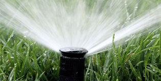 Automatic Garden Irrigation Spray Stock Photos