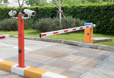 Automatic gate barrier. Automatic barrier for home village security system with CCTV royalty free stock images