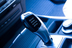 Automatic gear knob with appeal against fast driving. Modern car interior, automatic gear shift with appeal against fast driving Royalty Free Stock Image