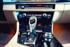 Automatic gear shifter in a, modern car. Car interior details. Automatic gear shifter in a new, modern car. Car interior with close-up of automatic transmission Stock Image
