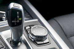 Automatic gear stick of a modern car, car interior details Stock Images