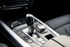automatic gear stick of a modern car, car interior details. stock photo
