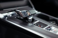 Automatic gear stick of a modern car, car interior details. royalty free stock photos