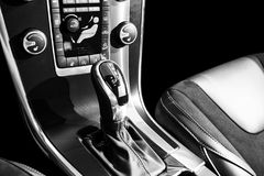 Automatic gear stick of a modern car, car interior details with electronic components. Black and white Royalty Free Stock Photo