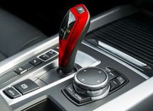 Automatic gear stick transmission of a modern car, multimedia and navigation control buttons. Car interior details. Royalty Free Stock Image
