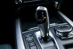 Automatic gear stick transmission of a modern car, multimedia and navigation control buttons. Car interior details. Transmission. Shift royalty free stock images