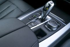 Automatic gear stick transmission of a modern car, multimedia and navigation control buttons. Car interior details. Transmission Royalty Free Stock Image