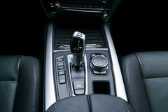 Automatic gear stick transmission of a modern car, multimedia and navigation control buttons. Car interior details. Transmission. Shift royalty free stock image