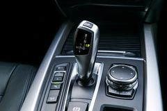Automatic gear stick transmission of a modern car, multimedia and navigation control buttons. Car interior details. Transmission Royalty Free Stock Images