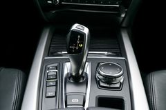Automatic gear stick transmission of a modern car, multimedia and navigation control buttons. Car interior details. Transmission. Shift stock photo