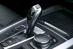 Automatic gear stick transmission of a modern car, multimedia and navigation control buttons. Car interior details. Transmission. Shift royalty free stock photo