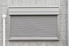 Free Automatic Gray Shutter Window Is Closed Stock Image - 199364721