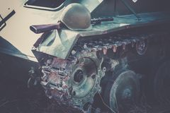 Automatic gun and military helmet of the Soviet soldier lie on the armor of the tank as an illustration of the fighting during the Stock Images