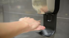 Automatic hand sanitizer stock video footage