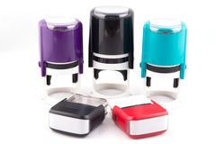 Automatic hand-stamps different colours. On white background Royalty Free Stock Photo