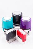 Automatic hand-stamps different colours. On white background Royalty Free Stock Photos