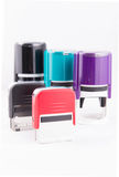 Automatic hand-stamps different colours. On white background Royalty Free Stock Images
