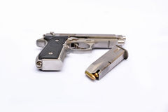 Automatic handgun pistol with magazine and bullets on white background Stock Photos