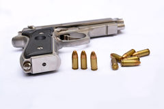 Automatic handgun pistol with magazine and bullets on white background Stock Photography