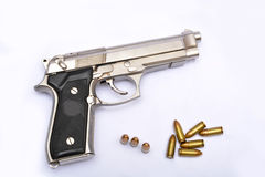 Automatic handgun pistol with magazine and bullets on white background Royalty Free Stock Image