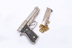 Automatic handgun pistol with magazine and bullets on white background Royalty Free Stock Photography