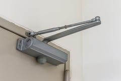 Automatic hydraulic leaver hinge door closer holder. Closeup Automatic hydraulic leaver hinge door closer holder stock photos