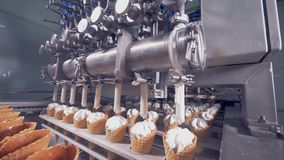 Automatic ice-cream production equipment. 4K stock video