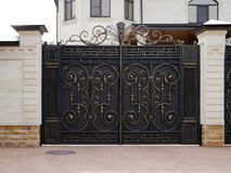 Automatic iron gate. With wrought-iron decor in the old style royalty free stock photos