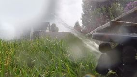 Automatic irrigation system watering lawn stock footage